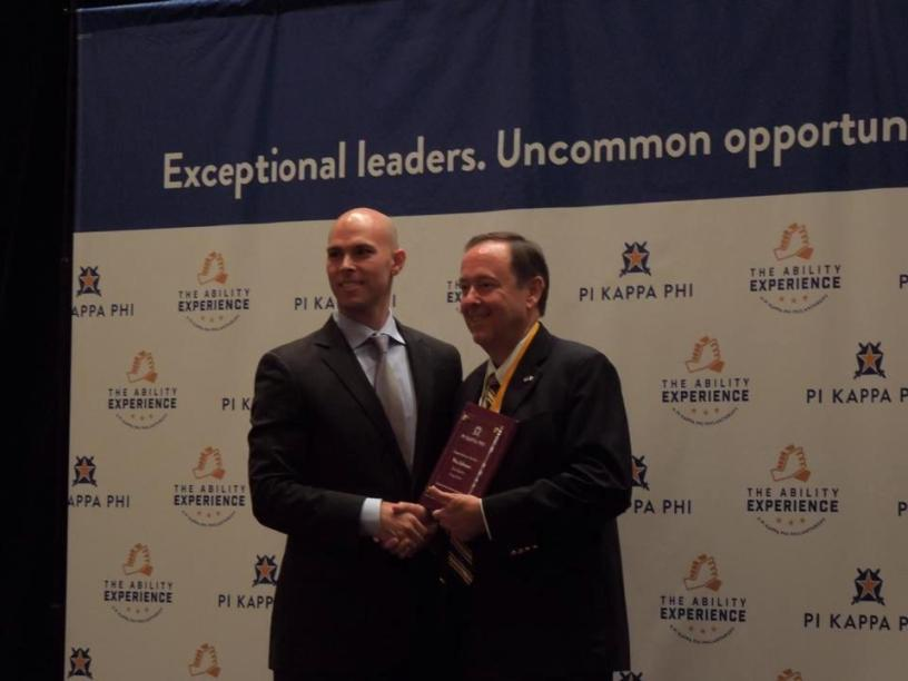 Accepting award from Pi Kappa Phi CEO Mark Timmes (Supreme Chapter Conference, August 2015, Atlanta)